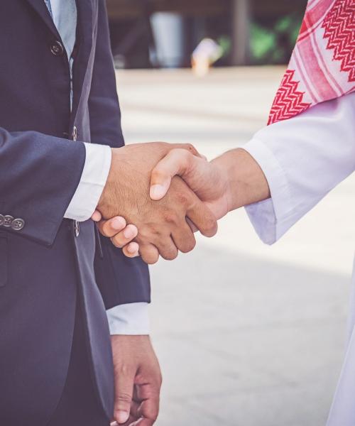 arabic-businessman-giving-handshake-his-business-partner-construction-site (1)-min